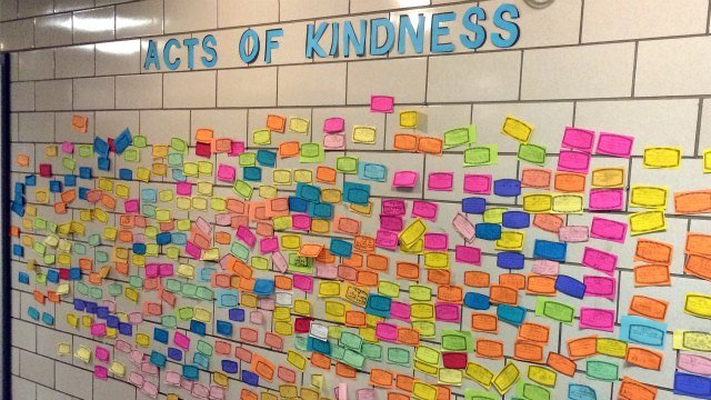 Slips of paper listing acts of kindness adorn the wall of the Pleasant Valley Elementary School in South Windsor. The school is one of many across the country asking children to perform 26 acts of kindness on the third anniversary (AP Photo/Michael Melia)