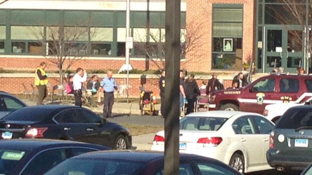 EMTs treat students at school in Oakville. (WFSB)