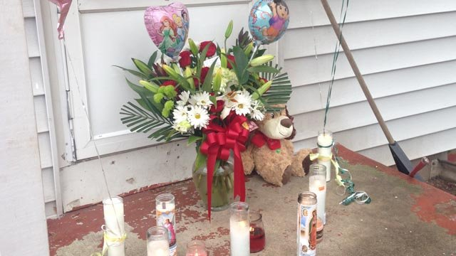 A memorial was set up outside of the victims' home. (WFSB photo)