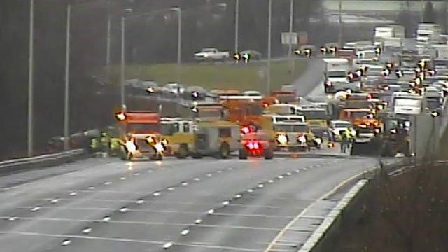 A gravel-carrying tractor trailer overturned on I-91 north in Wethersfield. (DOT photo)