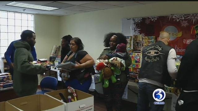 People helped gather toys for people in need after a theft from police substation. (WFSB)