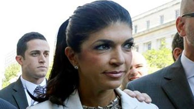 """In this July 30, 2013 file photo, """"The Real Housewives of New Jersey"""" star Teresa Giudice, 41, of Montville Township, N.J., walks out of Martin Luther King, Jr. Courthouse after an appearance in Newark, N.J. (AP Photo/Julio Cortez, File)."""