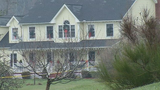 Crime tape surrounded a home on Birch View Drive in Ellington. (WFSB file photo)
