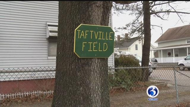 Community works to clean up Taftville Field. (WFSB)