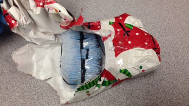 The gift-wrapped package of suspected heroin. (State police photo)