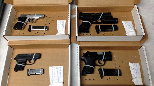 The guns recovered from the search of a home on Regent Street in Manchester. (Police photo)