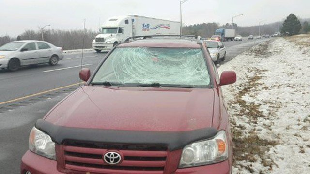 Troopers said this car was damaged from ice that fell off another vehicle on I-84. (State police photo)