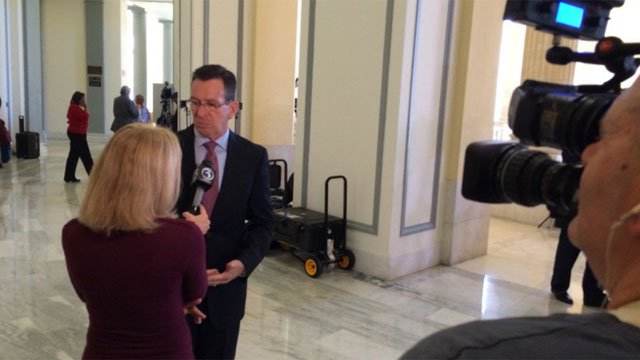 """Gov Malloy said people """"shouldn't vote for anyone who doesn't support background checks."""" (WFSB)"""