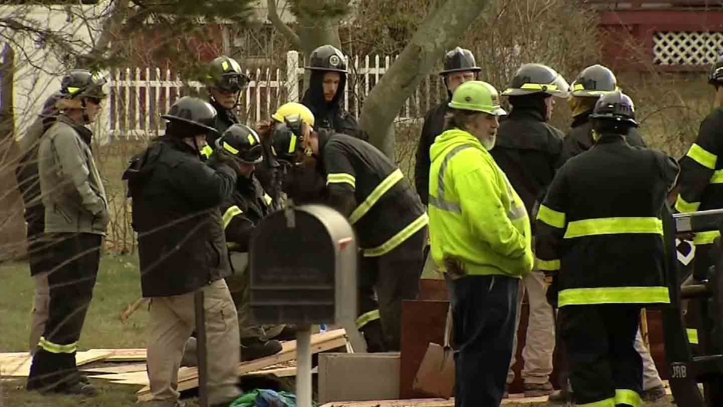 FBI investigators at a digging scene in Cromwell on Tuesday. (WFSB photo)