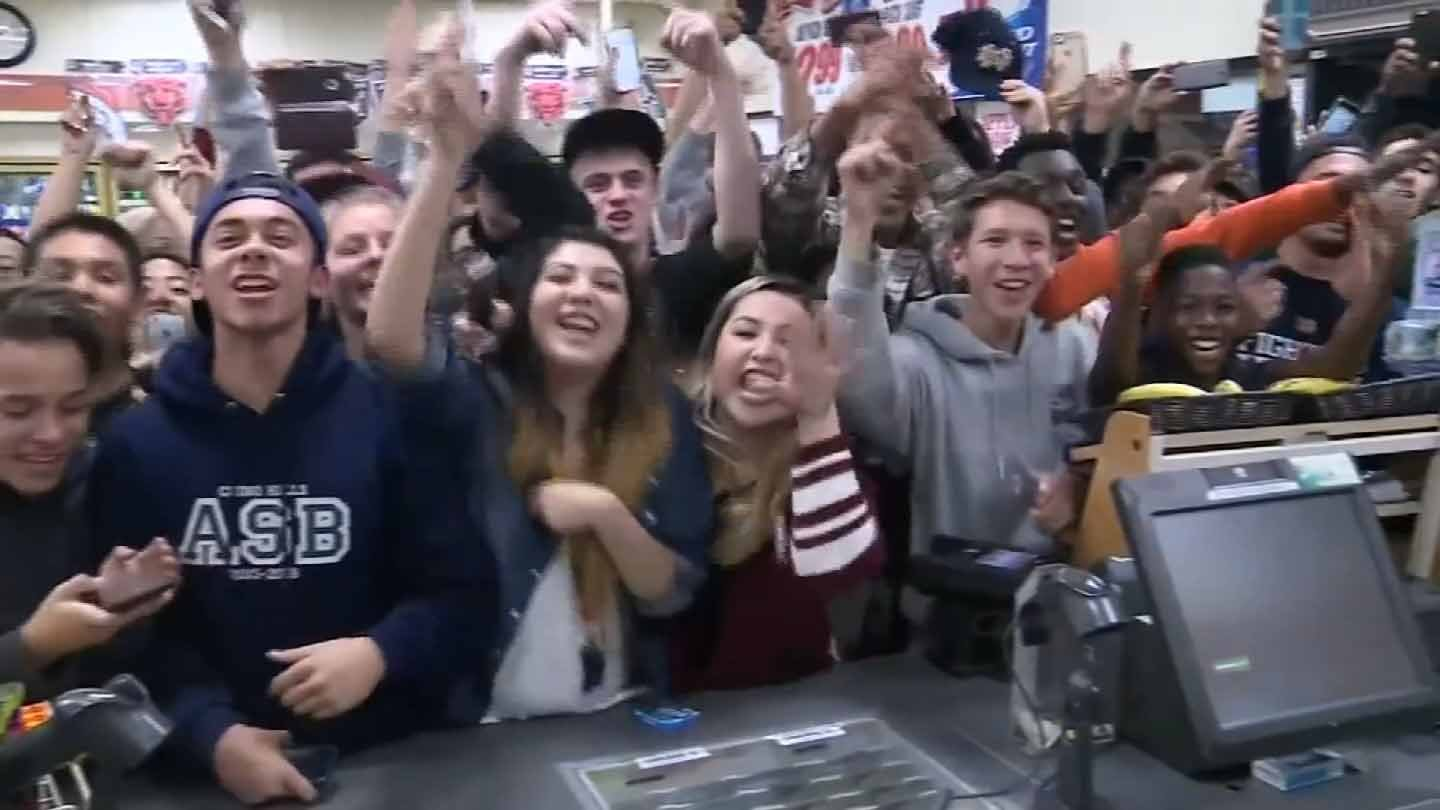 People in Chino Hills, CA celebrate after a jackpot winning ticket was sold there. (CBS photo)