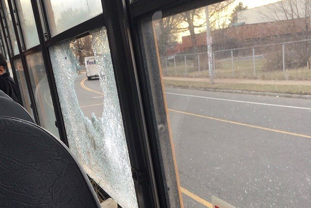 A group of people reportedly threw a large rock through a school bus window. (iwitness)