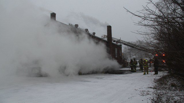 Firefighters battled the 3-alarm fire on Saturday afternoon. (Manchester Fire Department)