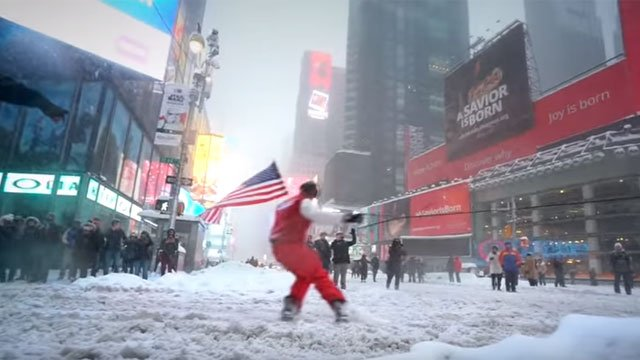 Casey Neistat snowboards through New York City. (YouTube)