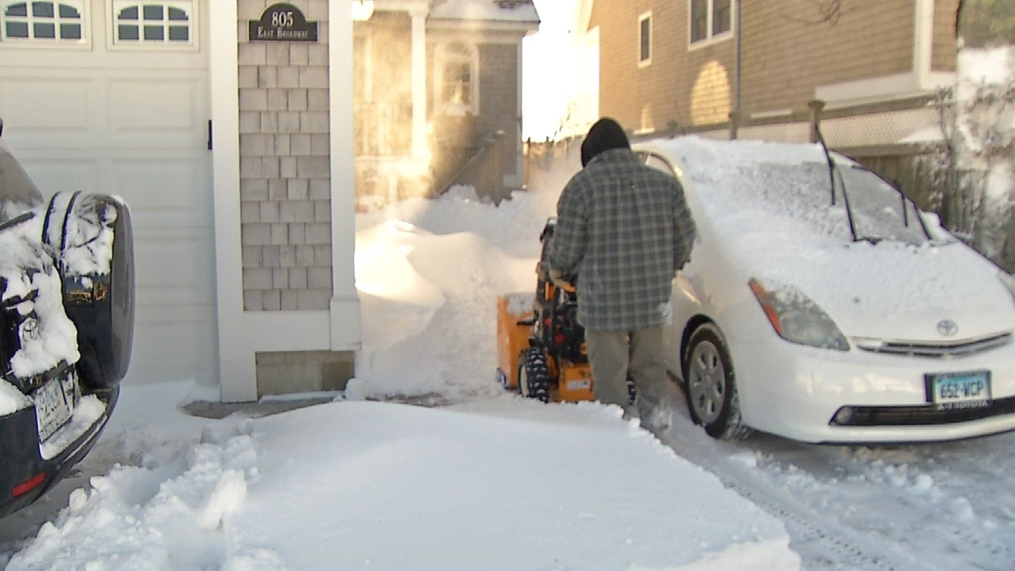Connecticut residents including in Milford spent Sunday snowblowing their driveways. (WFSB)