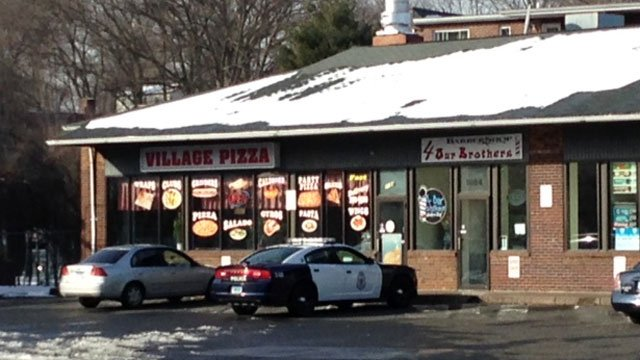 There was police activity outside Generis Caterers and Village Pizza in East Hartford. (WFSB)