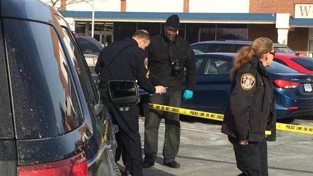 Officers gathered evidence in a shopping plaza in WIndsor on Monday afternoon. (WFSB)