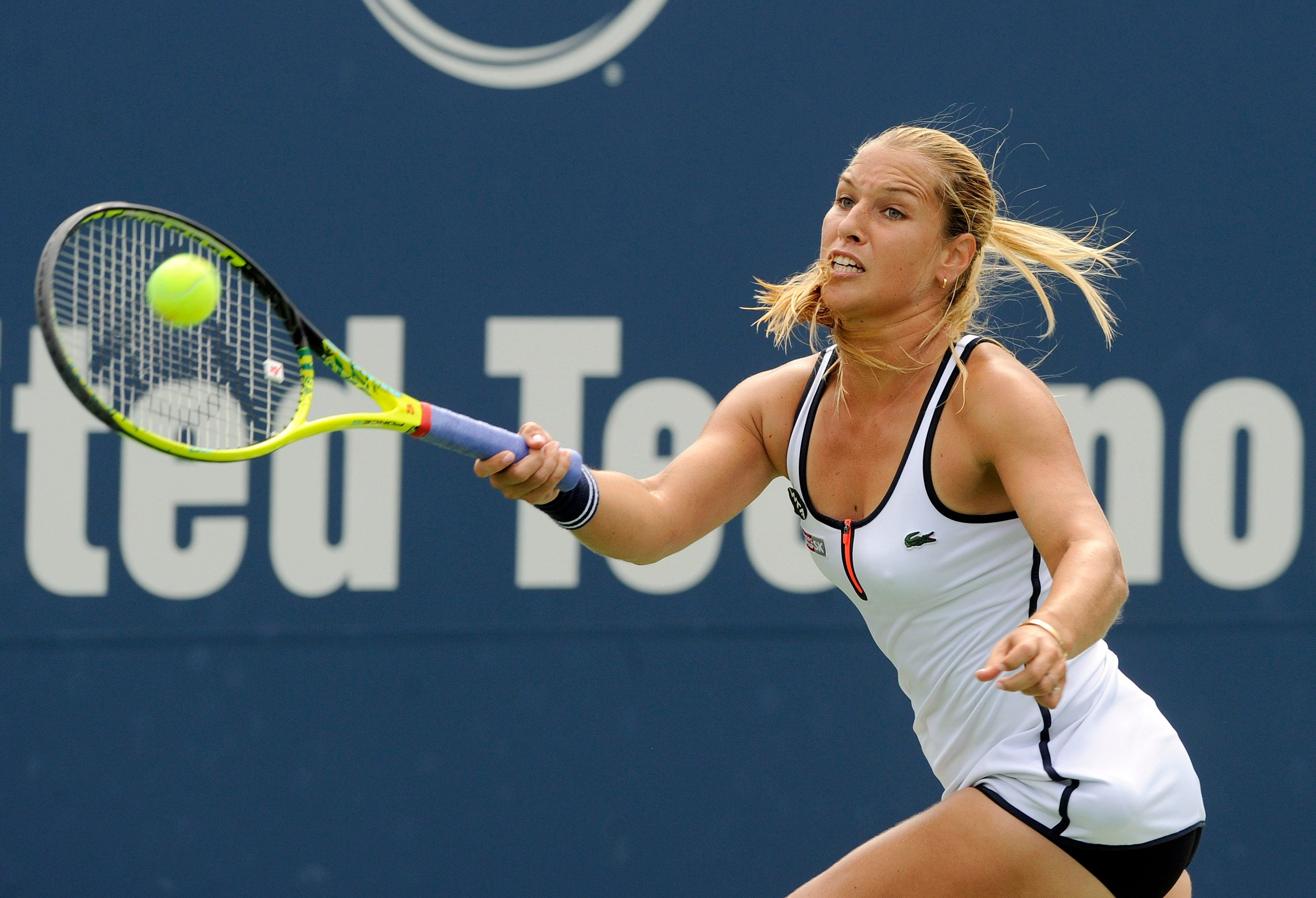Dominika Cibulkova, of Slovakia, reaches for a forehand during her match against Lucie Safarova, of the Czech Republic, during the semifinals of the Connecticut Open tennis tournament in New Haven, Conn., on Aug. 27, 2015. (AP Photo/Fred Beckham)