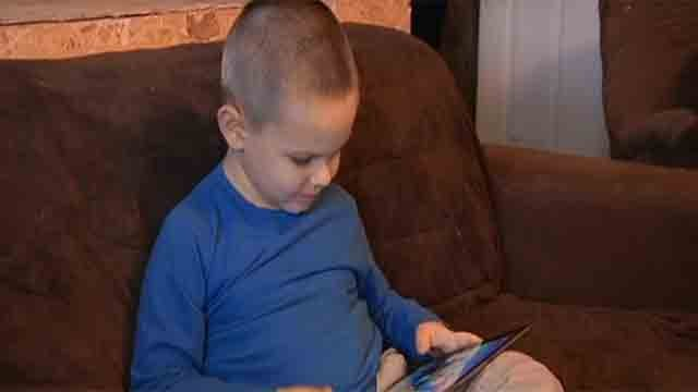 Four-year-old Chadwick DePew loves using tablets-- mainly to play games. (CBS News)