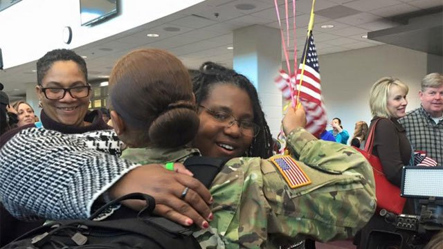 One solider with the 192nd Military Police Battalion reunites with a family member on Wednesday. (WFSB)