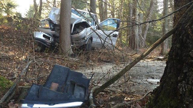 The vehicle crashed into a tree near a pond in Simsbury. (WFSB)