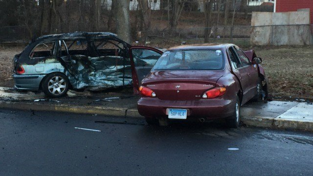 A car, allegedly driven by Martin, hit the police cruiser and then hit a green BMW, which caught fire. (WFSB)