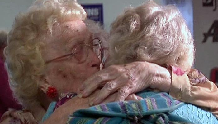 Lena Pierce, left, embraces her daughter, Betty Morrell, during their meeting at an airport in Utica, NY. (Source: WBNG/CNN)