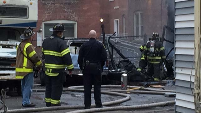 Firefighters battle garage fire in Hartford (WFSB)