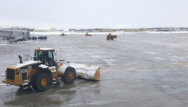 "Bradley International Airport tweeted ""On days like today, we sure are grateful for our snow removal team!"" (@Bradley_Airport)"