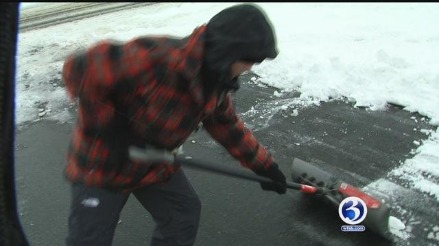 Children help parents clean up after Winter Storm Barbara. (WFSB)