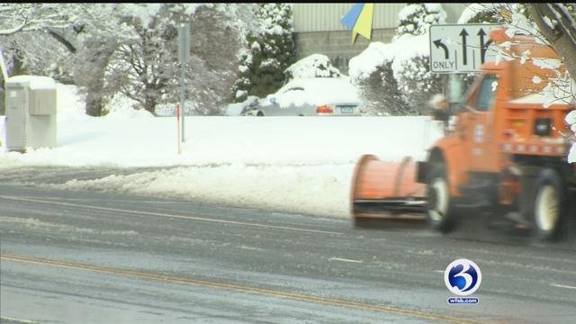 DOT crews worked to clear snow on Friday. (WFSB)