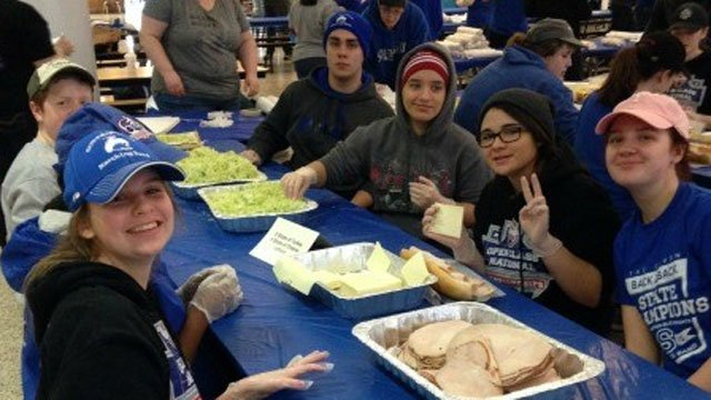 Members of the Southington High School Marching Band assemble subs. (WFSB)