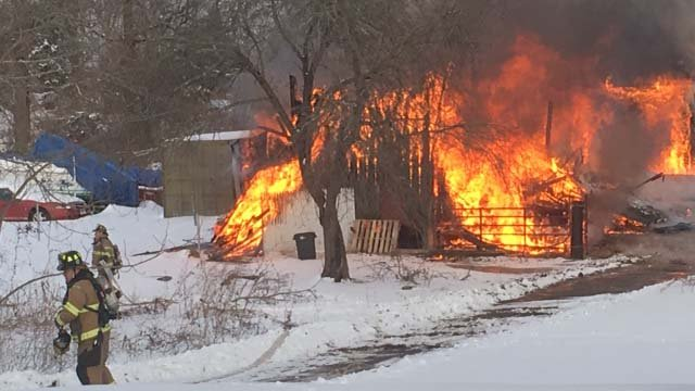 Crews are investigating what sparked a fire at a century-old barn in Groton on Tuesday. (iwitness)