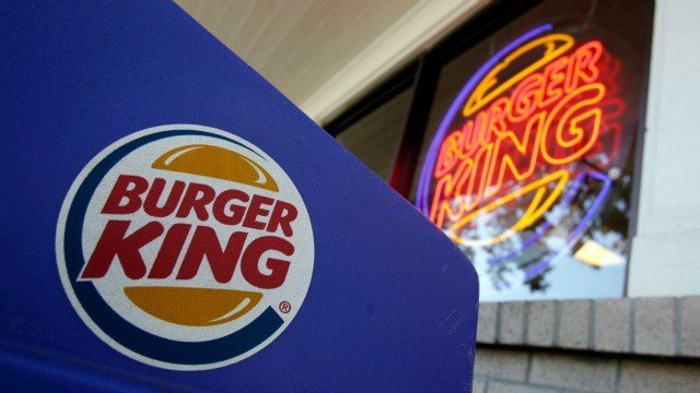 In this file photo taken Aug. 23, 2010, the Burger King sign is seen at a store in Mountain View, Calif. (AP Photo/Paul Sakuma, File)