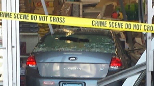 This car crashed into the Ocean State Job Lot in Groton on Friday. (WFSB)