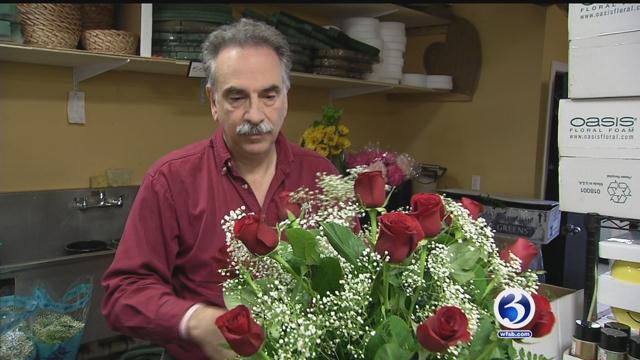 John Tornatore, who is the owner of the Gordon Bonetti Florist, works on an arrangement. (WFSB)
