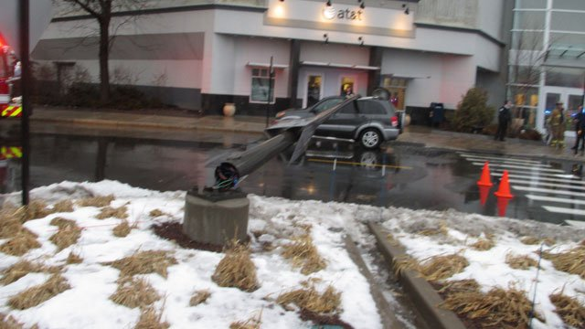 Light pole falls on SUV and injuries mom and child. (West Hartford Police Department)