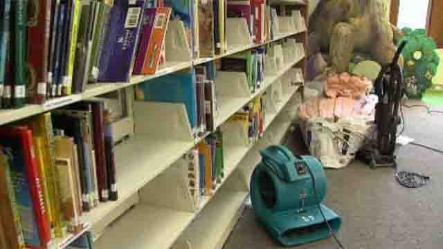 The library is closed after a pipe in the ceiling burst early Tuesday morning, soaking parts of the first floor. (WFSB)