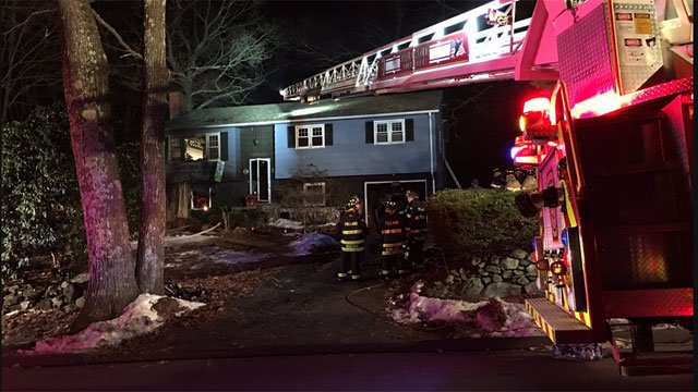 Four people escaped with no injury. One used a ladder. (WFSB)