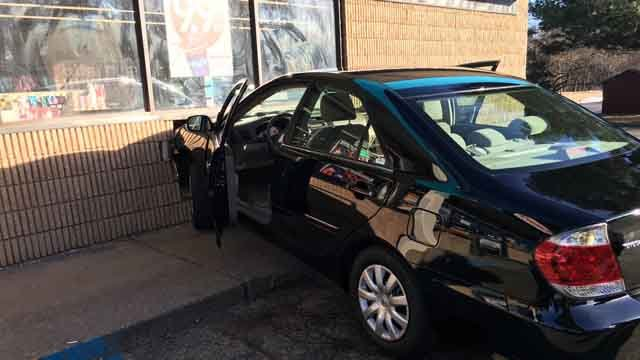 Police said the car crashed into the Valero FasMart convenience store, located on Route 83 at Regan Road. (Vernon Police)