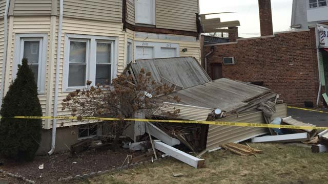 A mini-van crashed into a home on Quaker Lane in West Hartford on Tuesday. (WFSB photo)