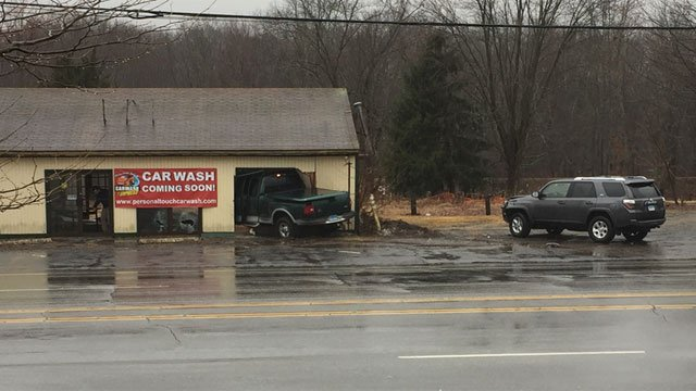 A truck crashed into a building in Cromwell on Wednesday. (WFSB)