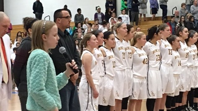 Glastonbury student Paige Drury sang before the Central Connecticut Conference girls' basketball championship game between E.O. Smith and South Windsor. (WFSB)