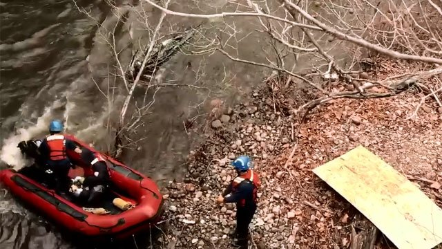 Firefighters rescue man stranded on piece of land with Naugatuck River rising all around him. (Waterbury Fire Fighters Association, IAFF Local 1339)