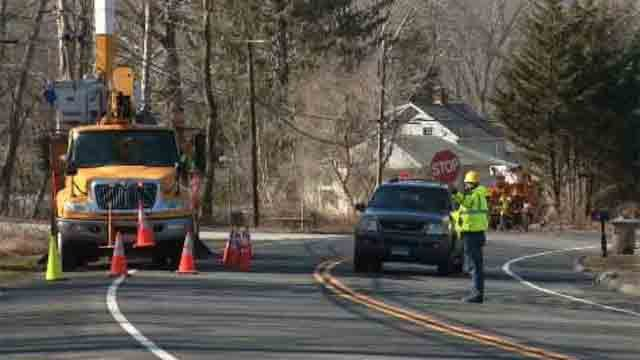 Crews worked to restore power outages in East Lyme on Thursday (WFSB)