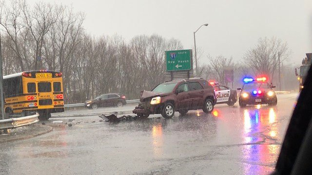 A crash involving a SUV and a school bus blocked off an entry ramp to I-91 south in Rocky Hill Monday morning. (WFSB)